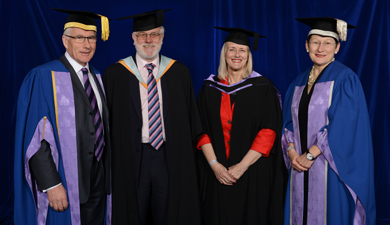 With Julie, left to right: Chair of the Board of Governors, John Hartley; Director of the Business School, Professor Aidan Berry and Vice-Chancellor of the university, Professor Debra Humphris.